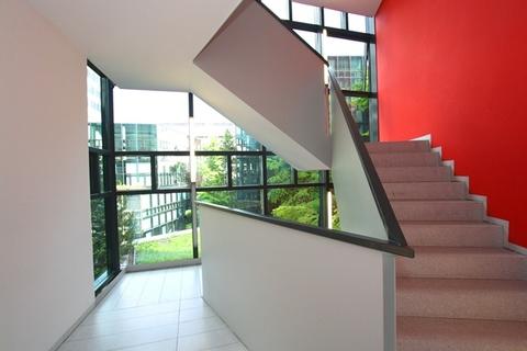 Treppenhaus STOCK - Futuristische Bürofläche in Maxvorstadt