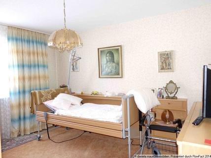 Schlafzimmer Ansprechende Terrassenwohnung mit drei Zimmern in ruhiger Lage
