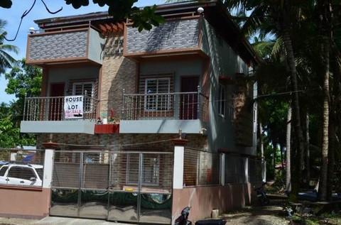 N59660012_mvc-001f.jpg Zweifamilienhaus in Philippinen in Stadt am Strand