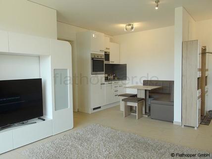 Bild 1 FLATHOPPER.de - Elegante 2-Zimmer-Wohnung mit Stellplatz und Balkon in München - Riem