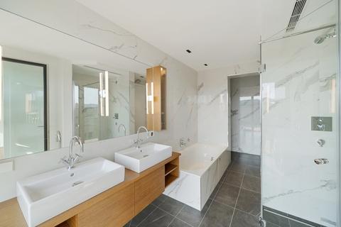 Badezimmer ON TOP OF VIENNA - Penthouse mit Infinity-Pool und Blick über ganz Wien!