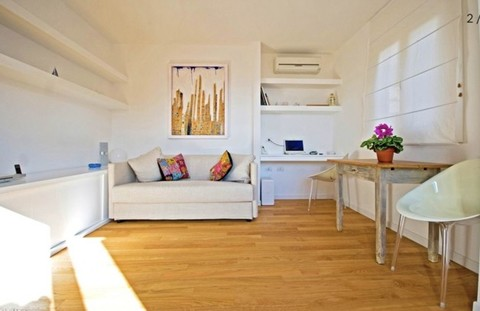 PI0423_mvc-001f.jpg Kleines Penthouse mit Porto Cagliari-Ansicht