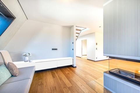 Wohnbereich (Teilillustration) Erstbezug: Penthouse mit Design-Interieur und Rooftop-Terrasse