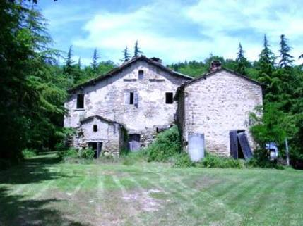 N12820003_mvc-001f.jpg Grosses ehemaliges Herrenhaus aus Naturstein auf einem Hügel.