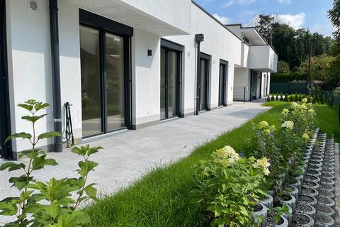 Gartenansicht Richtung Osten Eleganter Minimalismus!<br /> <br /> 4-Zimmer-Gartenwohnung <br /> in modernem Architektur-Ensemble