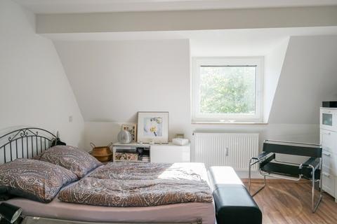 Schlafzimmer AIGNER - Kernsanierte Dachgeschosswohnung in Giesing