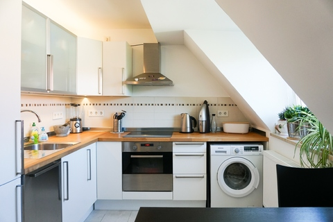 Küche AIGNER - Kernsanierte Dachgeschosswohnung in Giesing