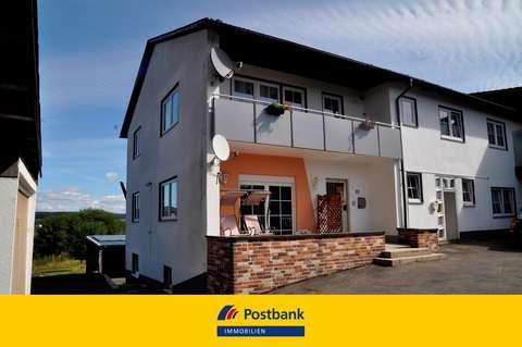 Hausansicht Klasse Eigentumswohnung mit potenzial