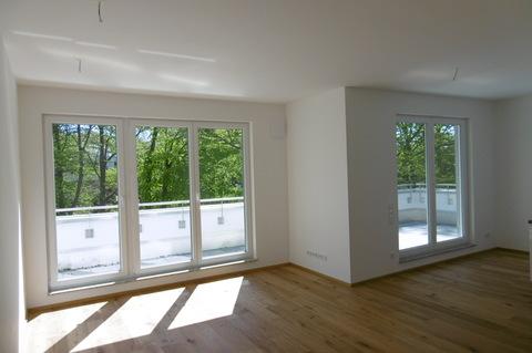 Wohnzimmer Dachterrassentraum: Erstbezug! Exklusive 3-Zimmerwohnung mit großer Dachterrasse!