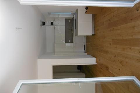 Blick ins Wohnzimmer Dachterrassentraum: Erstbezug! Exklusive 2-Zimmerwohnung mit großer Dachterrasse!