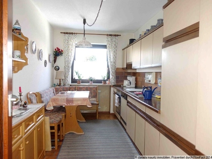 Große Küche Ansprechende Terrassenwohnung mit drei Zimmern in ruhiger Lage