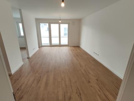 Wohnen Erstbezug: 1,5-Zi-Wohnung 1. OG, Balkon + Marken-Einbauküche!